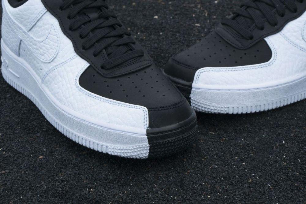 Белые и черные кроссовки. Преимущества